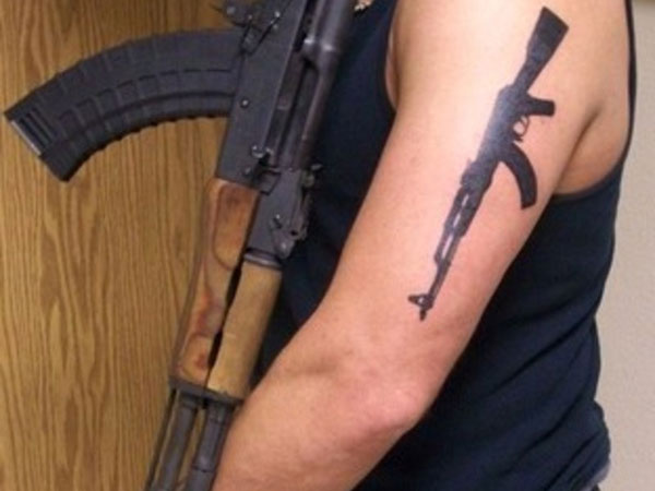 Gun Arm Tattoo