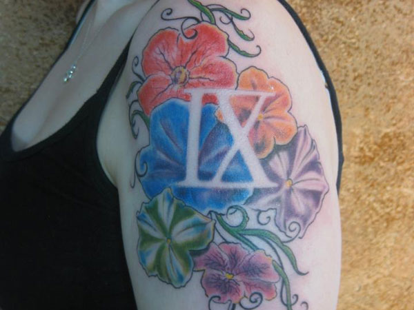 Roman numeral 9 floating over colorful flowers