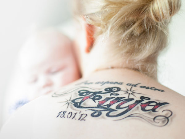 The name and date number tattoo