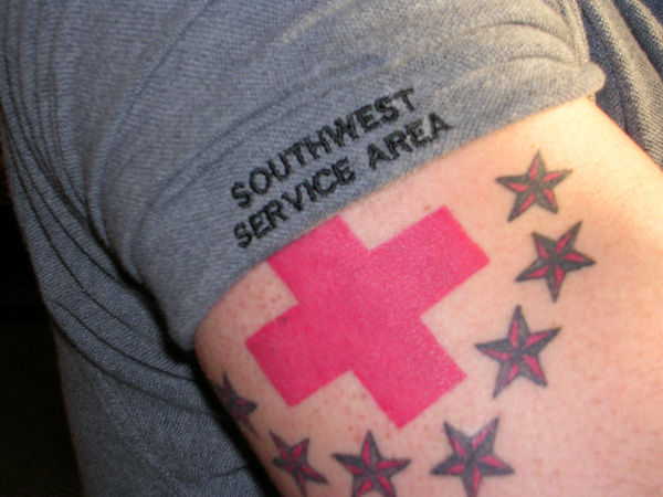 Small Cross Tattoo In Red