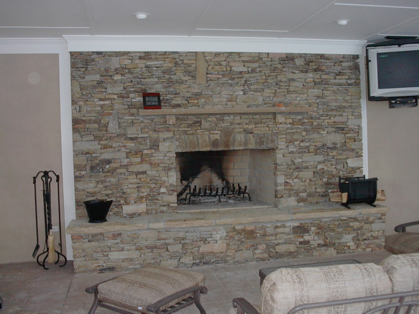 Stacked Stone Fireplace. The combination of pale stone with a warm fire burning at the heart is just what can make you feel toasty on a chilly winter evening.