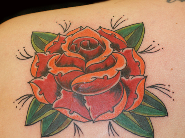 Red And Orange Traditional Rose Tattoo