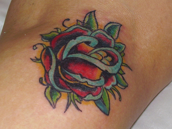 Cyan And Red Traditional Rose Tattoo
