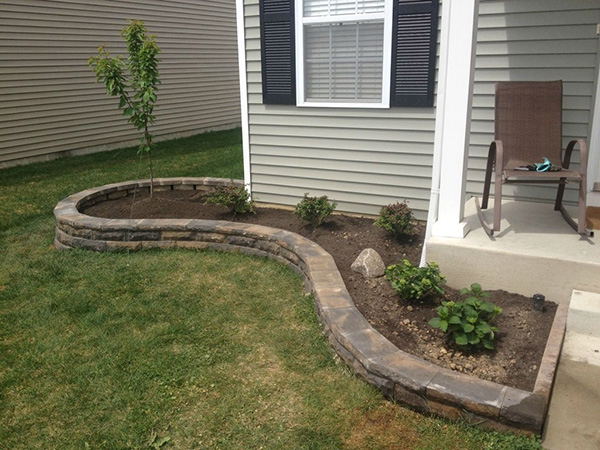 Simple Backyard Landscaping Designs : small backyard designed in a sober manner with grass bed and plant to