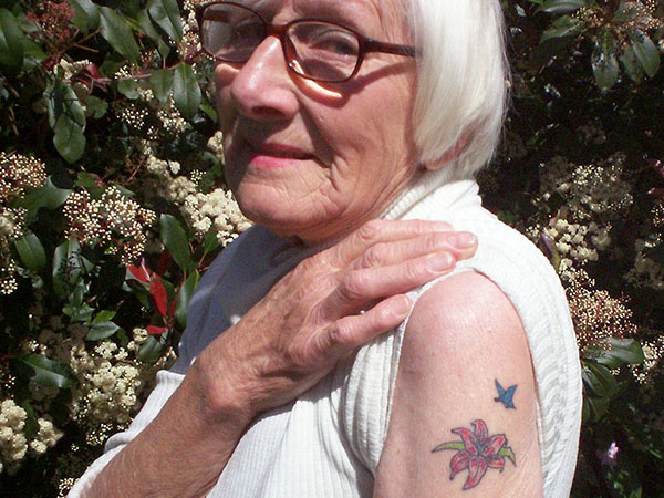 super woman 30 Remarkable Old People With Tattoos