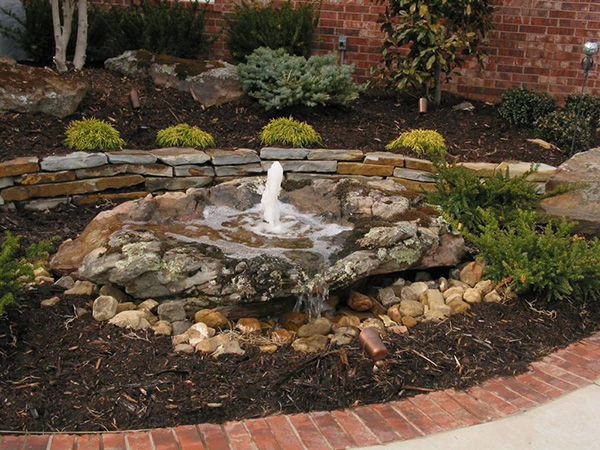 bubbling backyard 25 Spectacular Small Backyard Landscaping Ideas