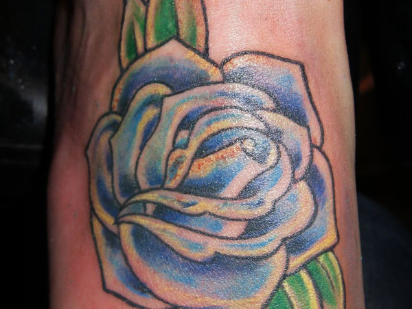blue rose foot 21 Unique Blue Rose Tattoo Designs