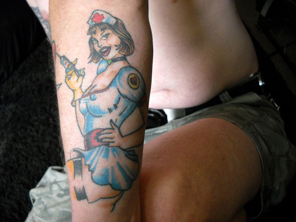 smilingtattoo 22 Adorable Nurse Tattoos