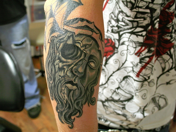 Ancient Face Theme Tattoo
