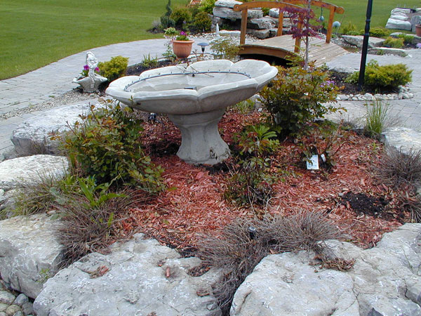 water feature 24 Simple Backyard Landscaping Ideas Which Look Exceptional