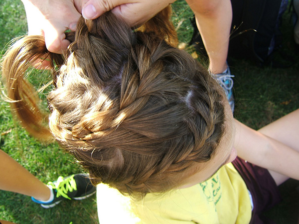 around the head 26 Stupendous Braided Hairstyles For Kids
