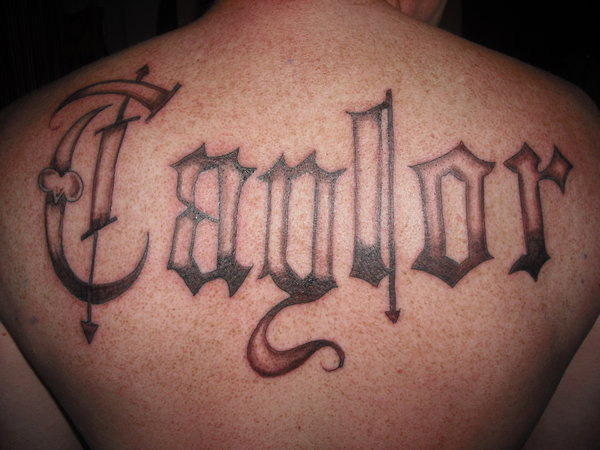 Pointed Edge Lettering Tattoo