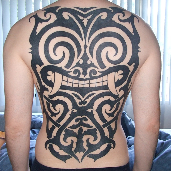 63b721090 27 Elegant Back Piece Tattoos - SloDive