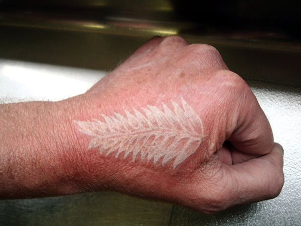silver fern tattoo 23 Fierce White Ink Tattoos On Black People