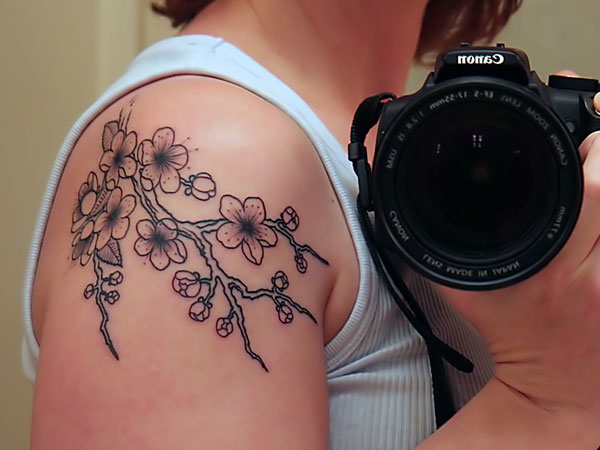 Artistic Flowering Tattoo