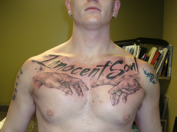hand 37 Exceptional Chest Tattoos For Men