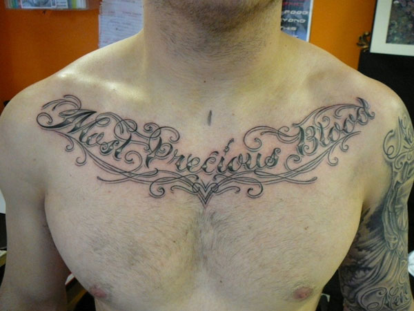 lettering 37 Exceptional Chest Tattoos For Men