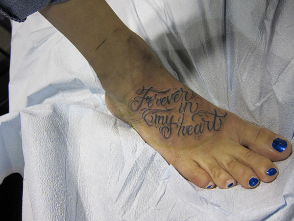 lovely foot tattoo 25 Refined Foot Tattoos Quotes