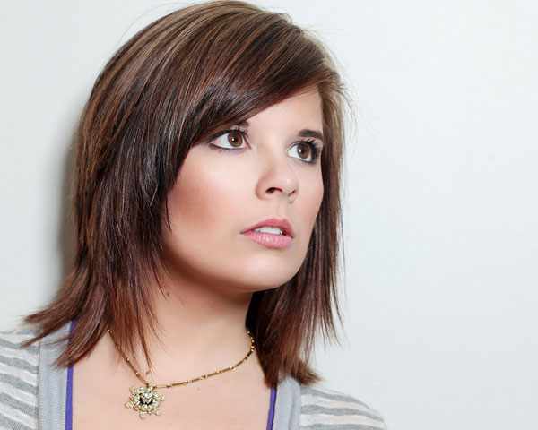 The straight edged medium length haircut with bangs goes well with the