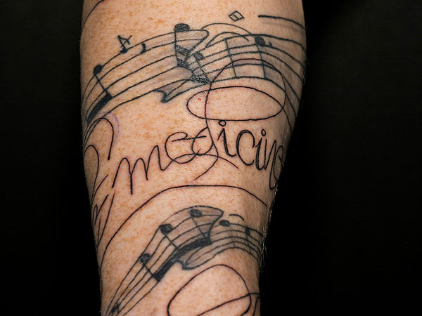 Funky Music Note Tattoo