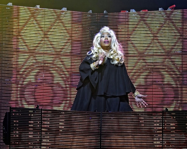 Locks tumbling down her shoulders gives nicki a dramatic look on stage