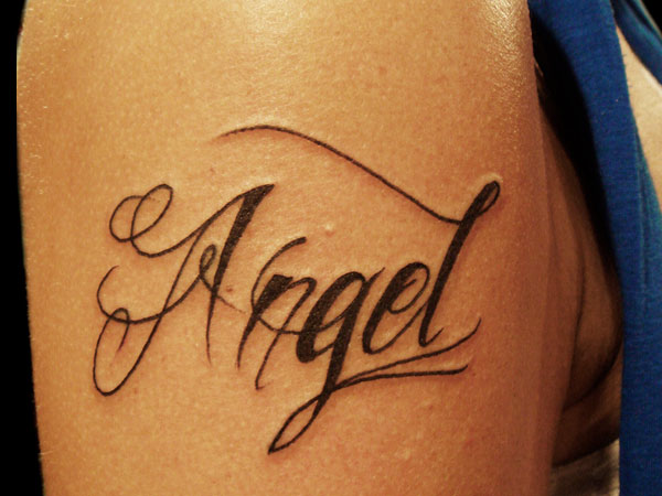 Angel Lettering Tattoo