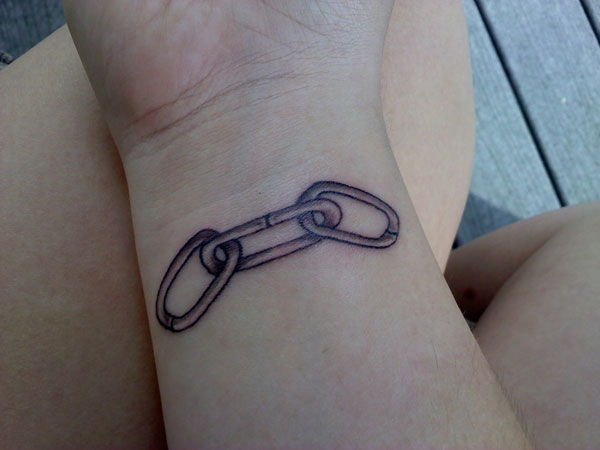 Unfree Wrist Tattoo