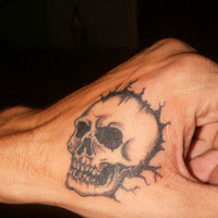 26 Tasteful Hand Tattoo Designs