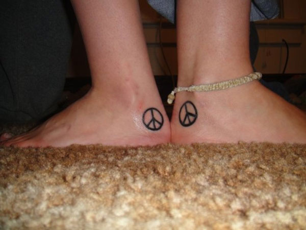 95f541395f710 24 Relaxed Peace Sign Tattoos For 2013