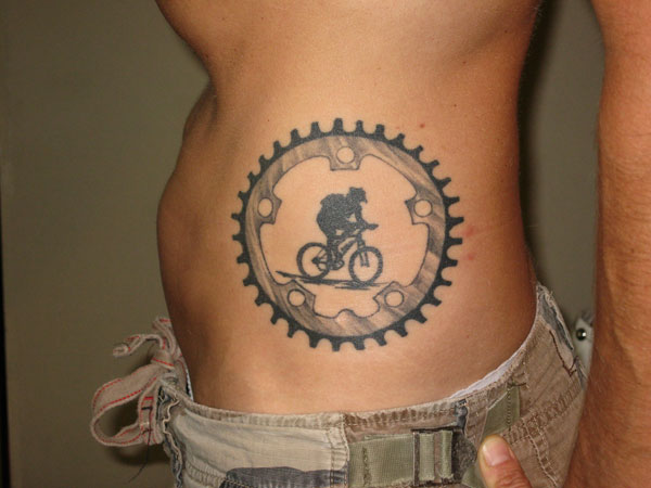 Cycle Rib Tattoo