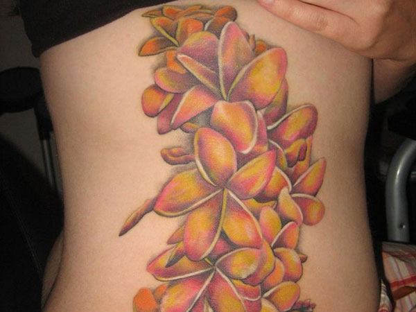 Golden Flowers Rib Tattoo