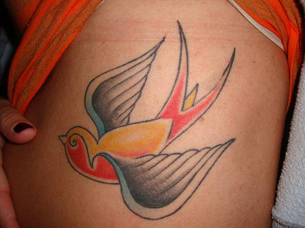 Swallow Rib Tattoo