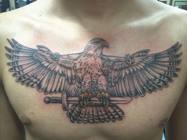 nice 27 Strong Chest Tattoos For 2013