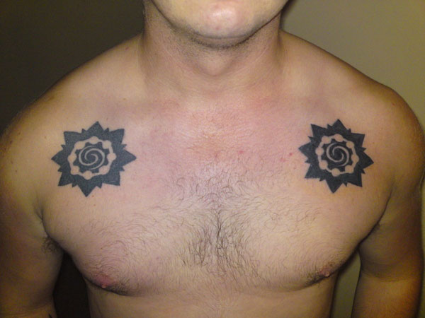 symbol 27 Strong Chest Tattoos For 2013