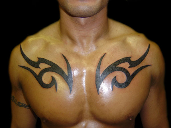 tribaltat 27 Strong Chest Tattoos For 2013