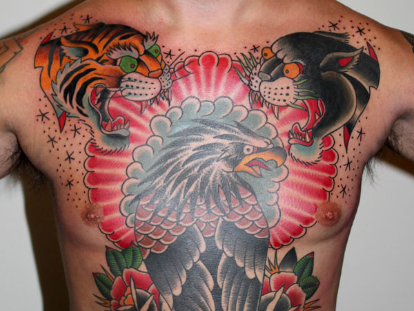 red backdrop adds drama to this angry animals tattoo on the back