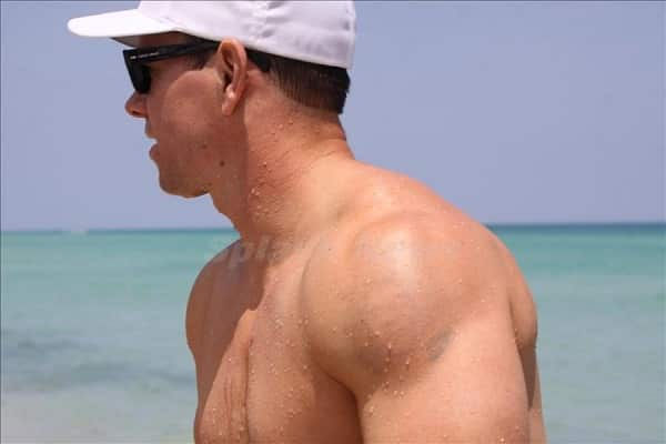 Mark Wahlberg's tattoo of Bob Marley on his shoulder still showing after the painful removal procedure