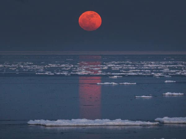 Rising Moon over Icy Water