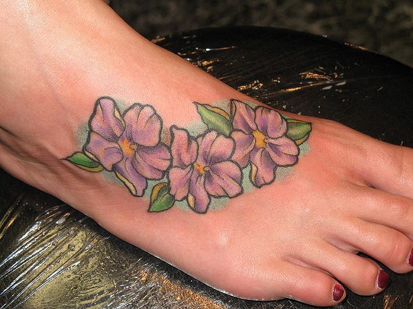 Three Pink Flowers Along the Side of the Foot