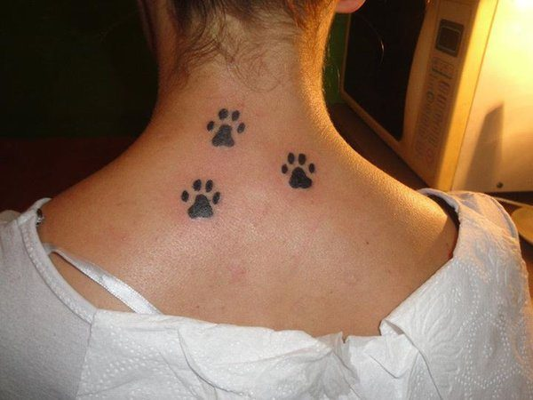 Back of the Neck Puppy Paw Print Tattoo