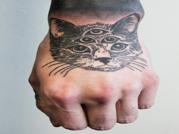 Cat with Many Eyes Back of Hand Tattoo