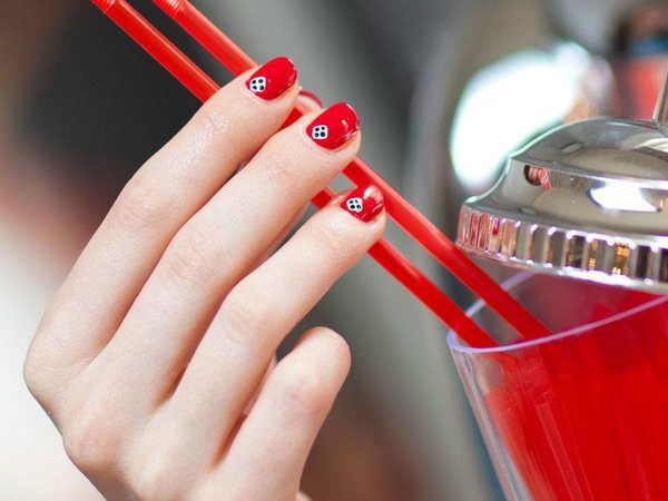 Red Nails with Single Dice at Cuticle