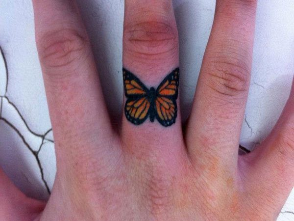 Beautiful Colored Butterfly Middle Finger Tattoo
