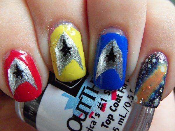 Red, Yellow and Blue Nails with One Single Comet Nail