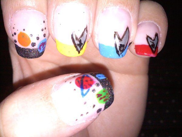 Clear Nails with Red, Yellow, Blue, and Black Tips and Space Decorations