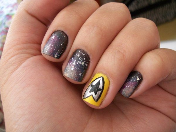 Milky Way Space Nail Design with Single Yellow Captain Nail and Insignia