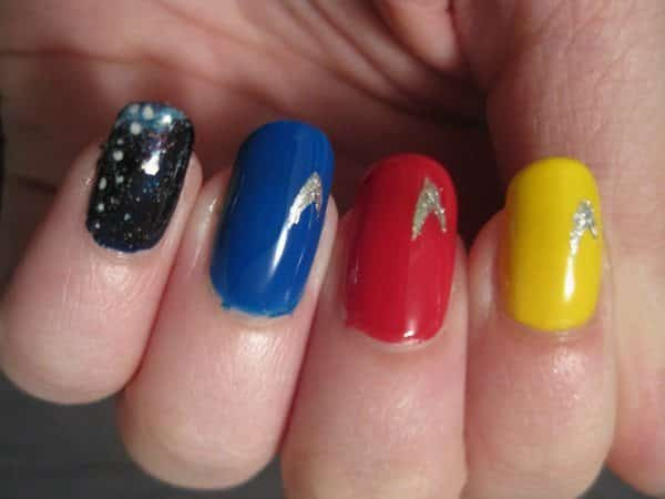 Red, Yellow, Blue Nails with Insignia and Single Milky Way Design Nail