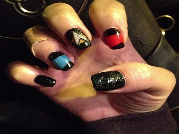 Black Glitter Nails with Red and Blue Nails and Insignia