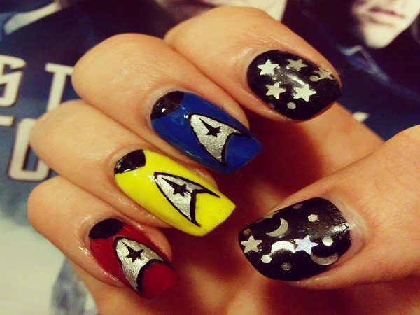 Black Nails with Silver Stars and Blue, Yellow, and Red Nails with Insignia