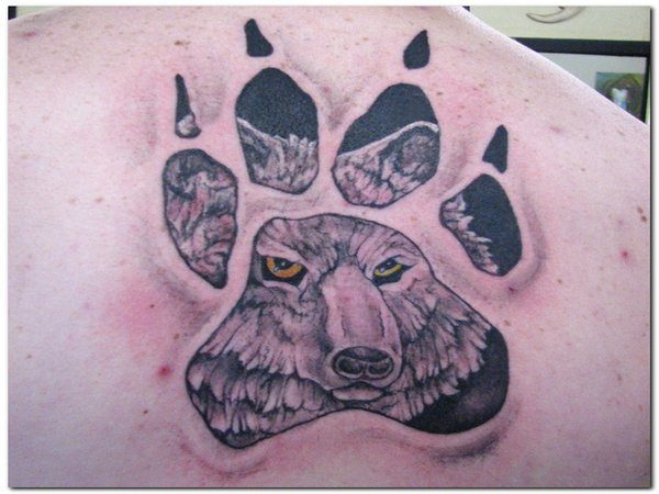 Wolf within the Paw Tattoo
